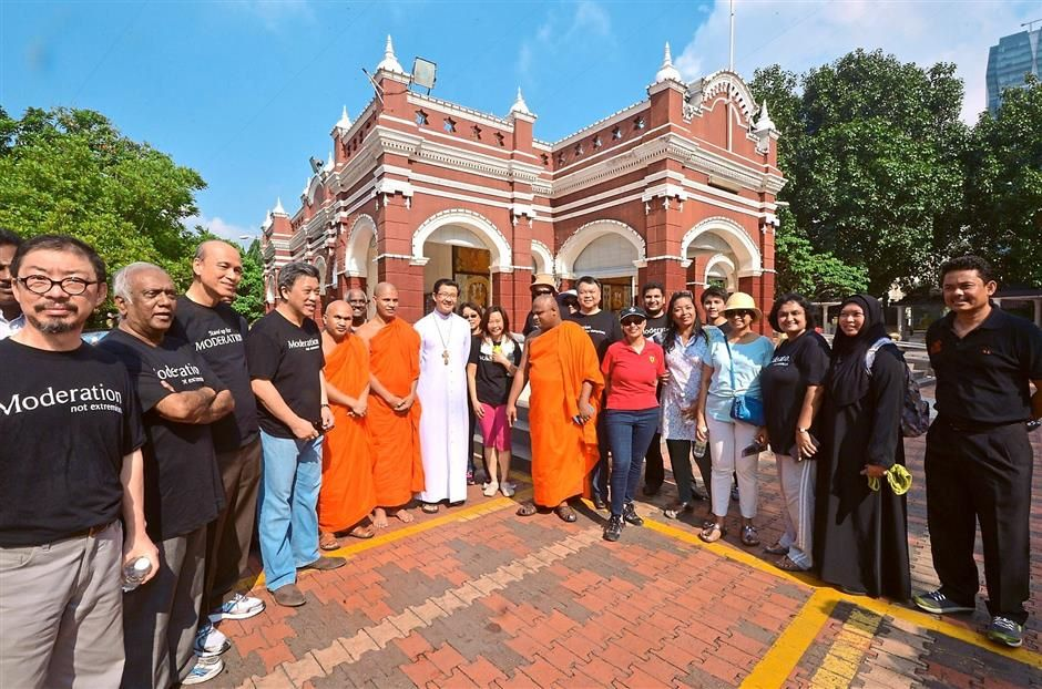 PARTICIPATING IN A SYMBOLIC WALK TO PLACES OF WORSHIP IN BRICKFIELDS